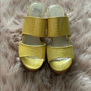 Yellow slip on wedges
